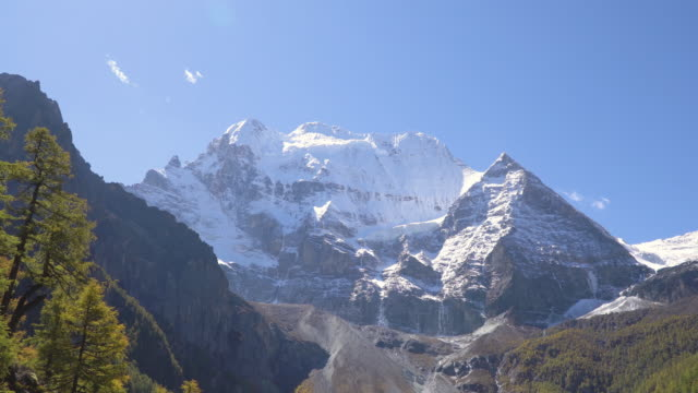 4k Tilt down; Snowcapped mountain at Yading nature reserve in China.