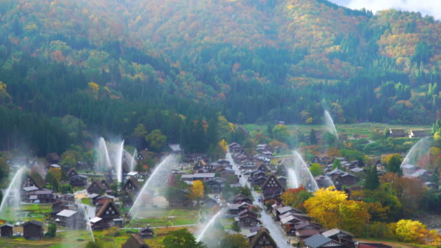 4k tilt down: water-discharge drill at shirakawago, gifu, japan. - tilt down stock videos & royalty-free footage