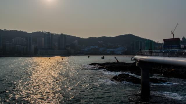 4k tilt up Time lapse of  Songdo Beach in Busan, South Korea, Asia