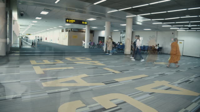 4k time lapse crowed of tourist people on a flight in airport terminal on a flight