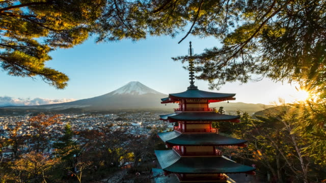 4k Time lapse Mt. Fuji with red pagoda in winter, Fujiyoshida, Japan