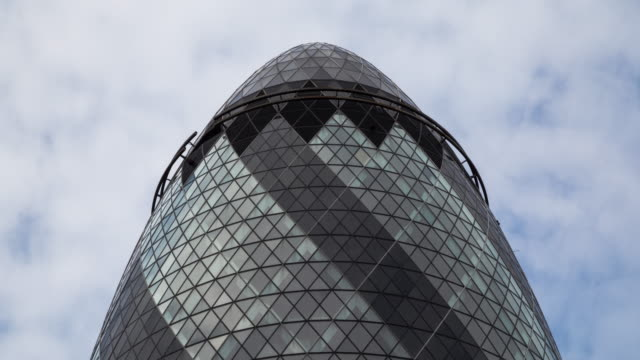 4k Time Lapse Of 30 St Mary Also Known As Gherkin 30 St Mary Also Known As Gherkin Is A Commercial Skyscraper Located In London's Primary Financial District, The City Of London And Also A Sir Norman Foster Building Which Is One Of The Most Popular Symbols Of The London. This Time Lapse Video Consists Of 390 Different High Quality Still Images And Every Image Edited Individually. Suitable For Using As High Resolution And High Quality Content. london architecture stock videos & royalty-free footage