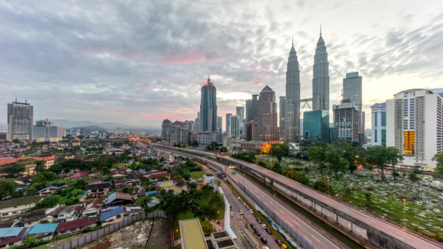 4k time lapse of dramatic sunrise at kuala lumpur city. moving and changing color clouds. aerial view. - malaysia stock videos & royalty-free footage