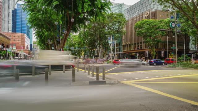 4 k tidsfördröjning på orchard road i singapore - fruktträdgård bildbanksvideor och videomaterial från bakom kulisserna