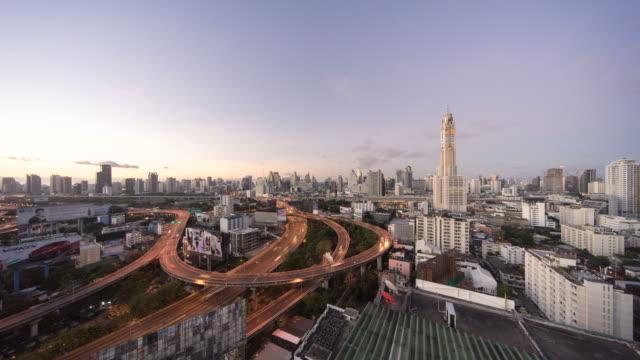 4k time lapse, Sunrise in Express way, Bangkok, Thailand Sunrise in 4k time lapse, multiple lane highway, Bangkok, Thailand with baiyoke 2 tower bangkok stock videos & royalty-free footage