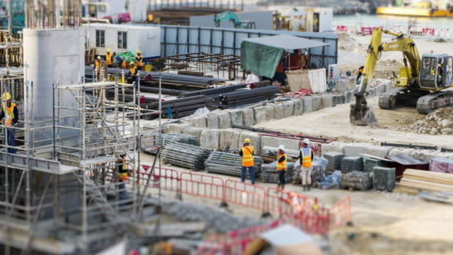 4k time lapse (4096x2160) :the construction site. (apple prores 422 (hq) format). - industria edile video stock e b–roll