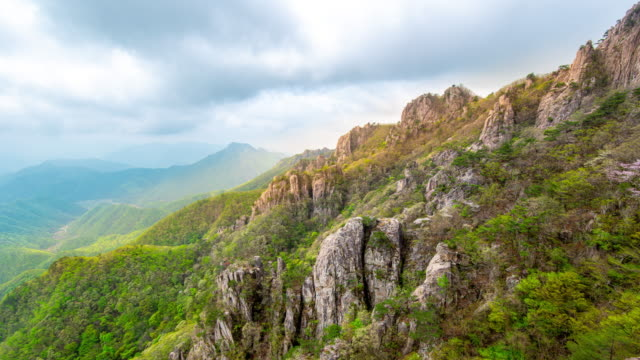 4k time lapse videos,the beautiful scenery of the daedunsan mountain in south korea summer season and the clouds covered.rocky mountains interspersed with green trees - rodzaj doliny filmów i materiałów b-roll