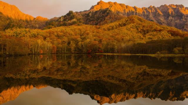 4k Time lapse wide shot of Kagamiike pond in autumn season, Nagano, Japan.