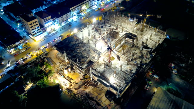 4k time-lapse: aerial view of working construction site - construction filmów i materiałów b-roll