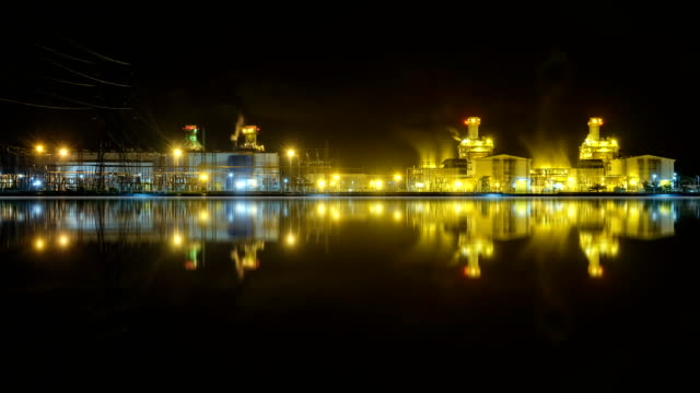 4k timelapse at night of combined cycle powerplant 4k timelapse at night of combined cycle powerplant with steam from cooling tower gas pipe stock videos & royalty-free footage