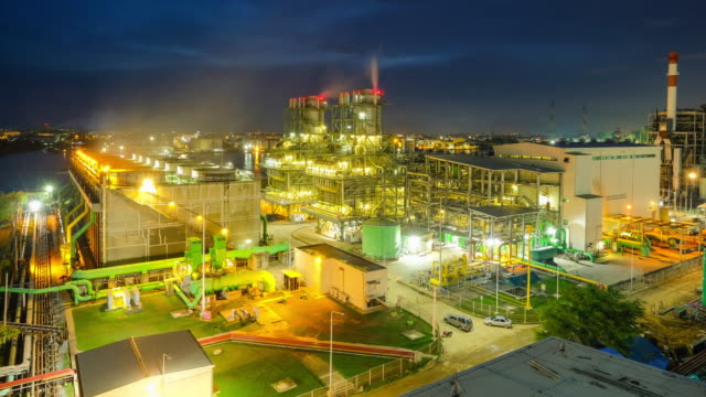 4k timelapse day to night of combined cycle powerplant with Cooling Tower near river at south east asia