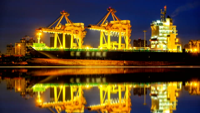 4k timelapse of Cargo ship in the harbor at sunrise video