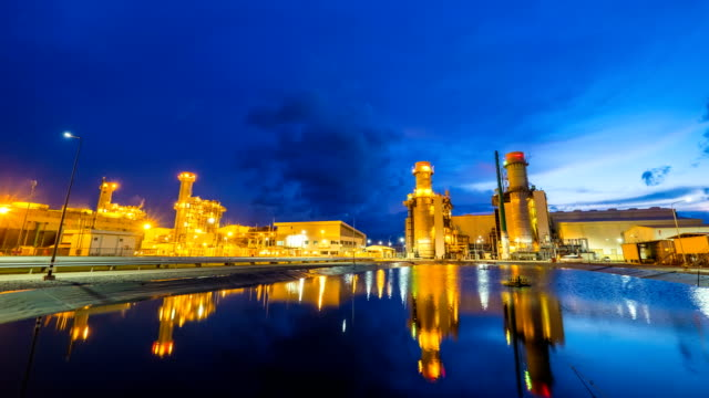 4k timelapse of combined cycle powerplant or fuel gas powerplant - centrale elettrica video stock e b–roll