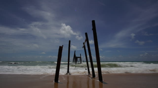 4k Time-lapse of Sea beach and old ruins wooden bridge. video