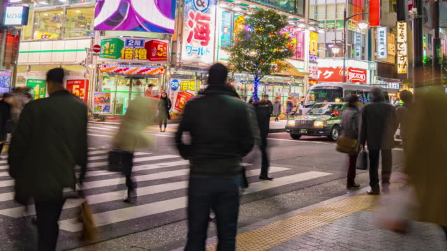 4k time-lapse of Shimbashi commercial and night life district near shimbashi station with crowd of people, crowd across road in shimbashi. video
