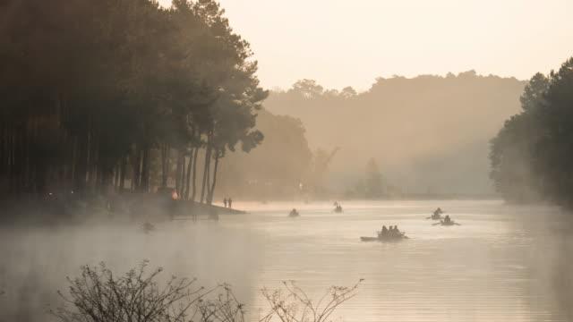 4k: Timelapse shot of bamboo rafting in lake video