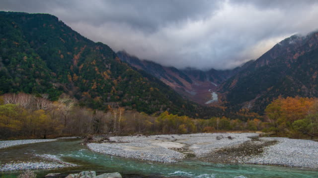 4k Time-lapse with dolly right of Kamikochi in autumn season, Nagano, Japan. 4k Time-lapse with dolly right of Kamikochi in autumn season, Nagano, Japan. Beautiful landscape and colourful background in japan autumn leaf. high dynamic range imaging stock videos & royalty-free footage