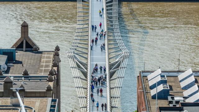 4k TL People on Millenium bridge over river Thames, London video