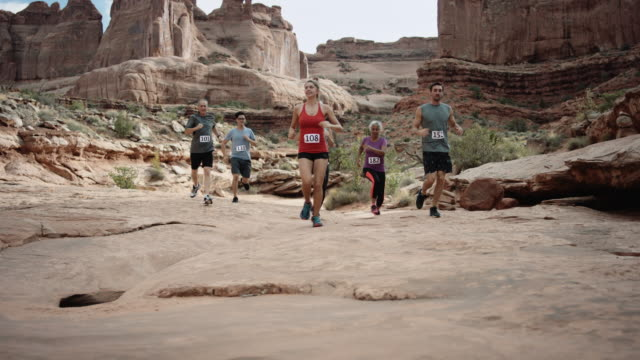 4k UHD: Mixed group running a race through canyon lands video