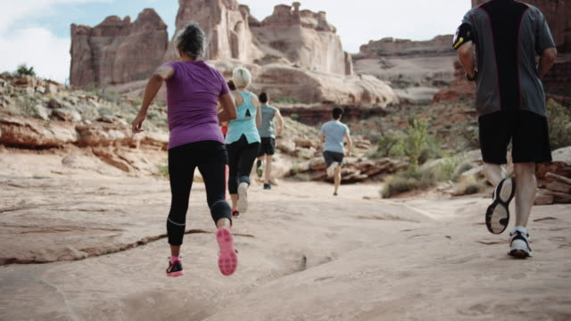 4k UHD: Runners in a canyon video