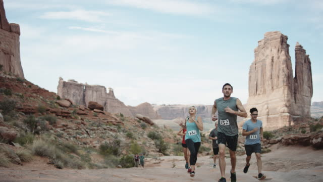 4k UHD: Runners participating in a race through canyons video