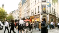 istock 4k uhd slowmotion crowd walking people across street with traffic and facade shop in BRussel belgium famouse destination of europe 1211368356