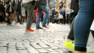 istock 4k uhd slowmotion crowd walking people across street with traffic and facade shop in BRussel belgium famouse destination of europe 1211371455