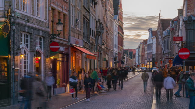 4k uhd timelapse crowd tourists shopping grote market square street historic town at bruges belgium famous destination sunset - bruges video stock e b–roll