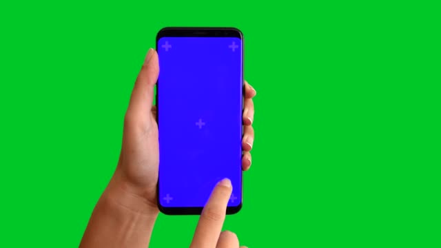 4k using smart phone displaying chroma key blue screen 3 - phone hand filmów i materiałów b-roll