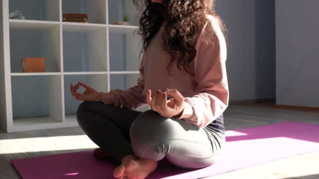 4k Video Of Adult Woman Doing Yoga Exercises In Living Room video