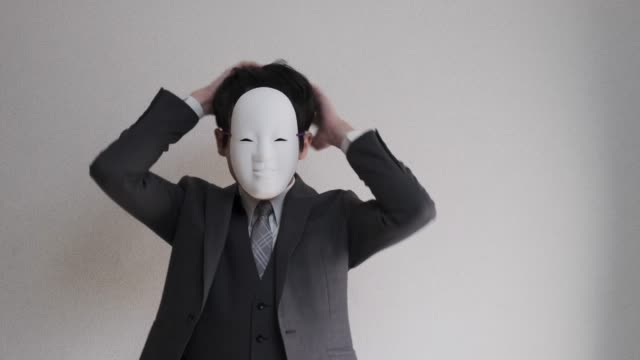 4k video of strange masked businessman who getting himself ready