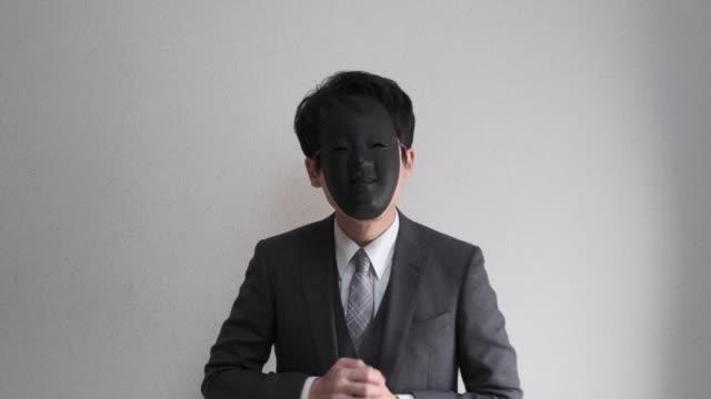 4k video of strange masked businessman who hospitality