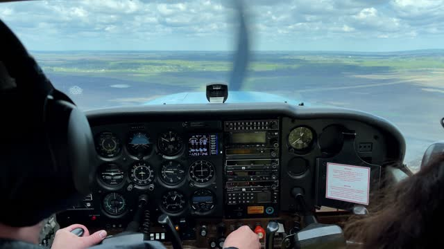 4k View from cockpit of a small propeller plane.