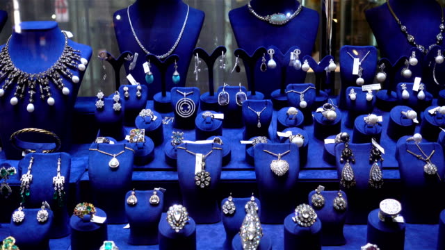 4k view of jewelry with precious stones on blue coasters