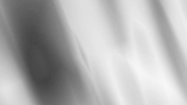 4k: waving silver fabric background. seamless loop - argentato video stock e b–roll