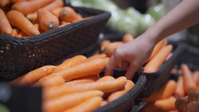 4k woman hand choosing carrots out of the basket shelf at super market grocery store shelf, fresh vegetable, lifestyle healthy eating, organic products, veggie food recipe menu, ingredient vitamin local supermarket, indoors scene carrot stock videos & royalty-free footage