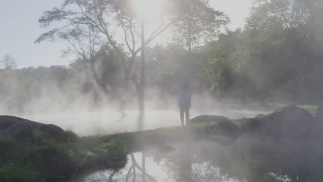 4k ,Woman standing in the Geyser hot spring