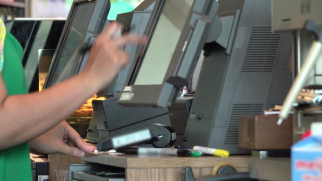 4k: worker using touchscreen cash register at cashier Payment register stock videos & royalty-free footage