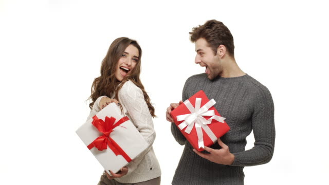 4k Young couple showing presents in Chrismas day on white background. video