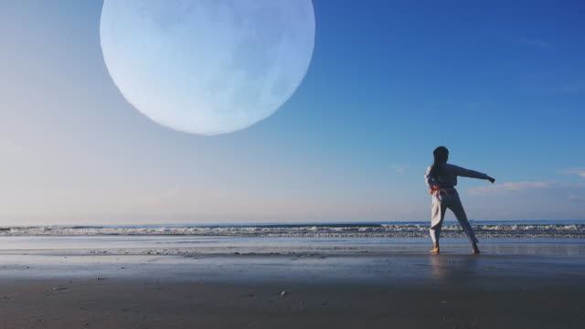 4k: Young women Practising Martial Arts Outdoors On the beach, Full moon background