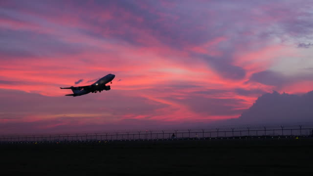 4K:Airplane take off in evening and twilight sunset sky video