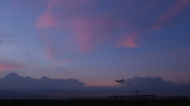 4K:Airplane takeoff in evening and twilight sky video