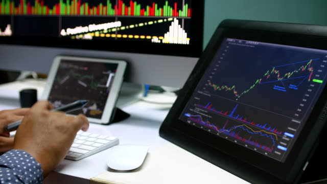 4K:Businessman looking at graph stock Data on Laptop video