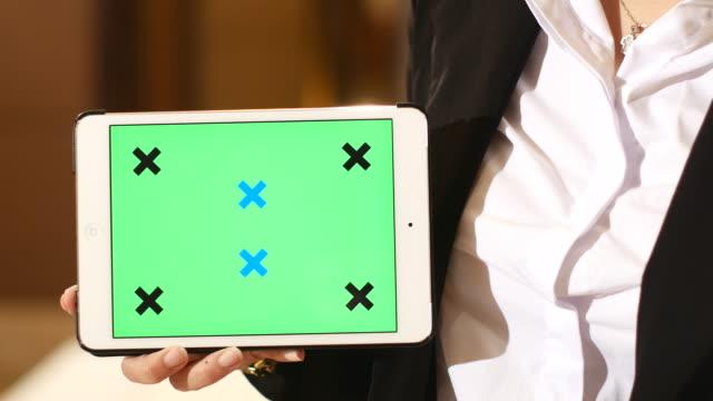 4K:Businesswoman presentation her digital table,Gree screen video