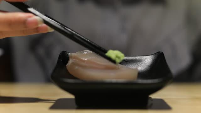 4K:Close up chopstick pick up salmon sashimi japan food video