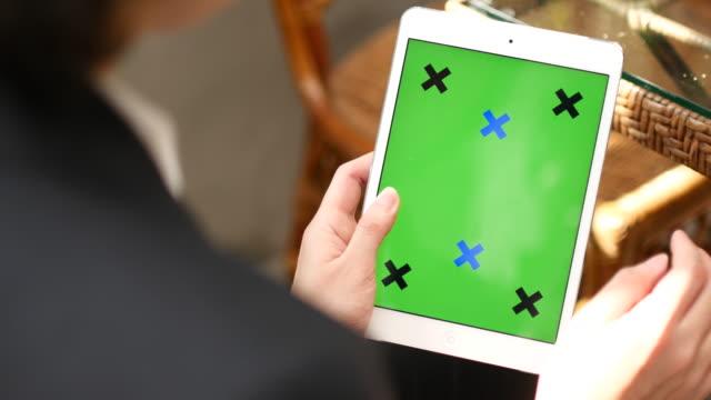 4K:Close up of using digital tablet,Green screen video
