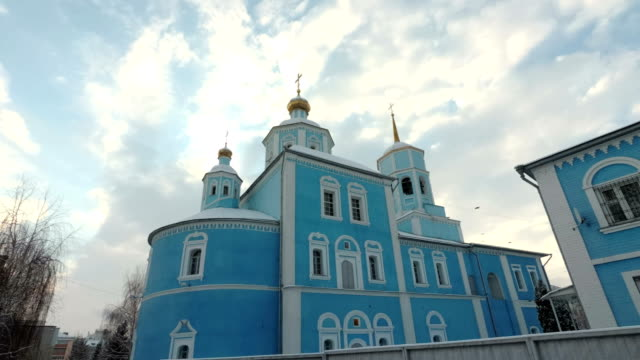 4K.Domes of Orthodox Church on background of blue sky. Smolensk Cathedral, Belgorod, Russia video
