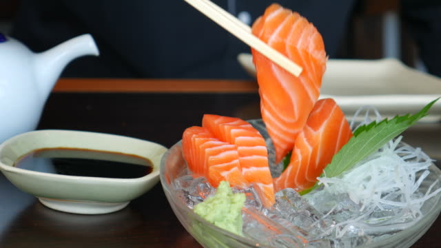 4K:Eating Salmon Sashimi video