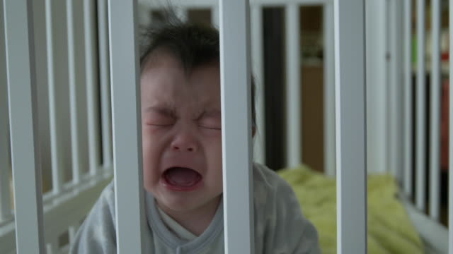 4K,Japanese baby start crying in her crib. video