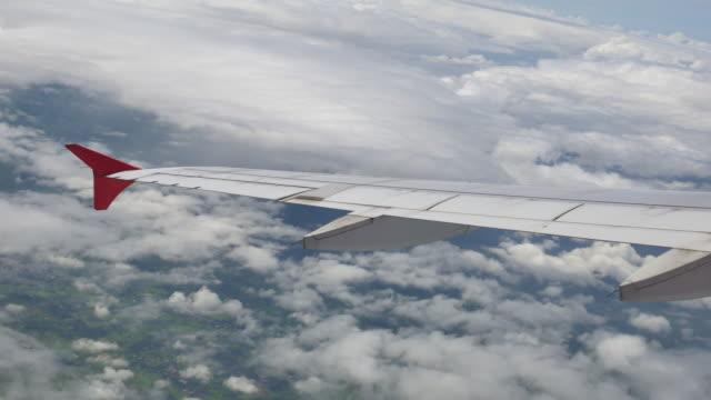 4K:Plane window  and cloud sky video